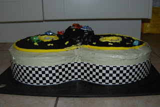 Once the hill was on the cake, I filled in the rest of the race car track with chocolate cookie crumbs, pressing the crumbs down into the cake.