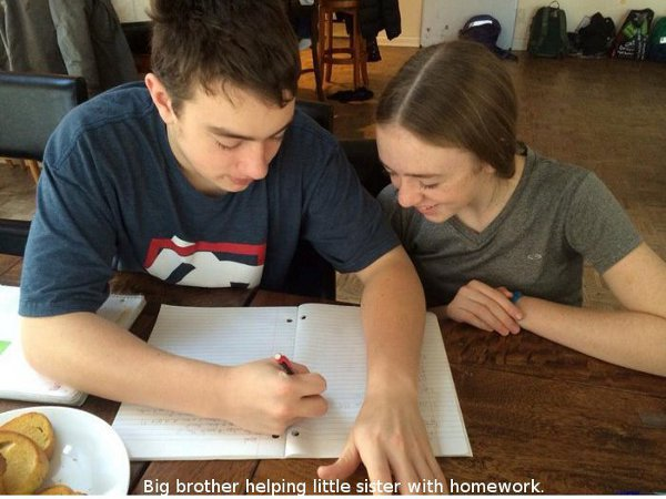 big_brother_helping_little_sister_with_homework.jpg